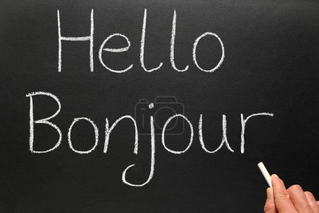 Photo for Bonjour, hello in French written on a blackboard. - Royalty Free Image