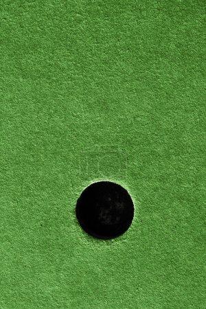 Crazy golf course hole artificial grass.