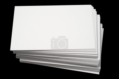 A stack of blank white business cards.
