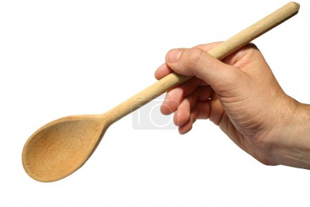 Holding an old wooden spoon.