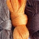 Background image skeins of wool yarn...