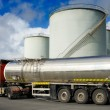Truck with fuel tank and industrial cilinder conta...