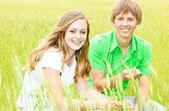 Happy Teens in the field. Focus on girl.