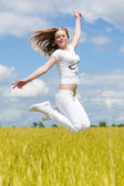 Girl jump in the field