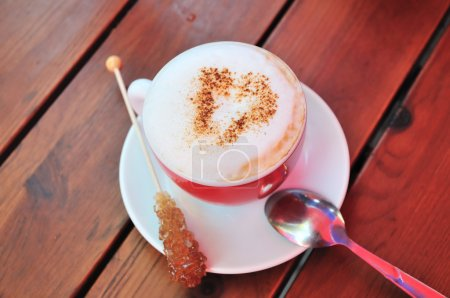 Photo for Cup of cappucino with choc heart over milk skin - Royalty Free Image