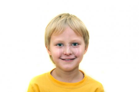 Photo for Little adorable young boy smiling over white - Royalty Free Image