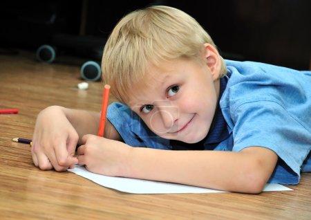 Left-hander boy is drawing