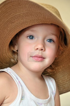 Funny girl wearing huge hat