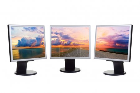 Panorama of sunset on computer screens