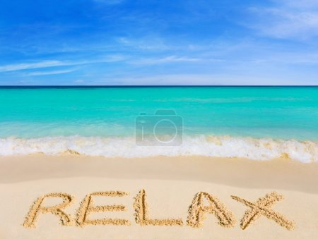 Word Relax on beach - vacation concept background...