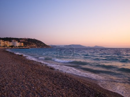 Rhodes town Aegean sea coastline afterglow. Rhodes...
