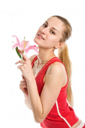 Nice girl with a pink lily