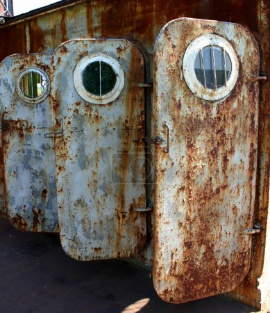 Old rusted doors with portholes