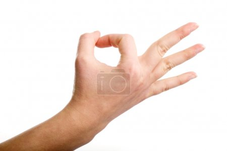 """Photo for Female hand demonstrating """"OK"""" gesture on the white background - Royalty Free Image"""