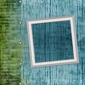 Blank frame on old wooden background