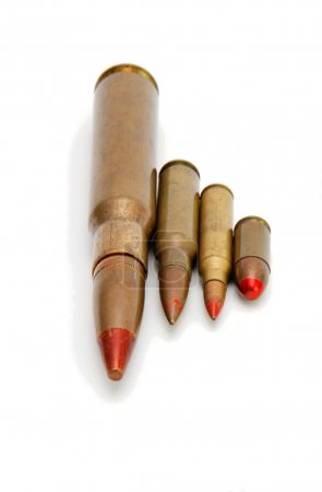 Four red-tipped tracer cartridges