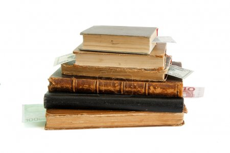 Photo for Stack of old books with banknote bookmarks isolated - Royalty Free Image