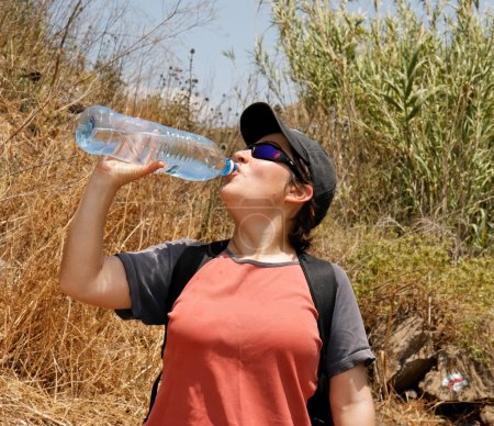 Young woman drinks mineral water