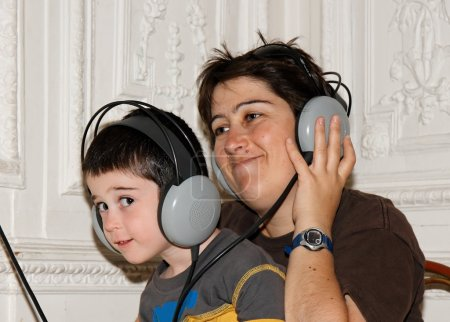 Mother and boy listen to music
