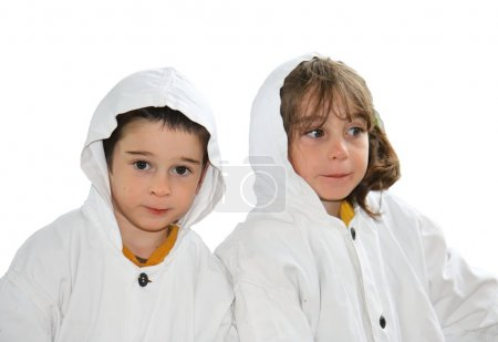 Cute little boy and girl in white cloaks
