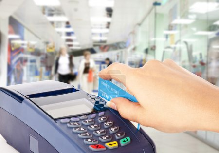 Photo for Human hand holding plastic card in payment machine in shop - Royalty Free Image