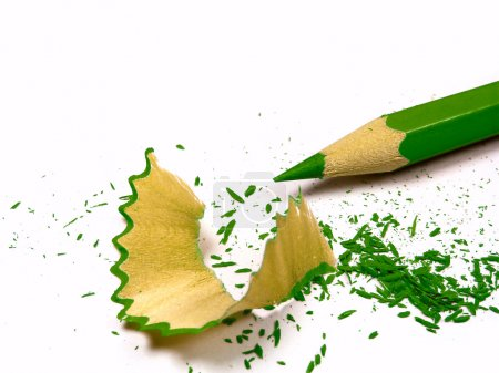 Green pencil with sharpening shavings. Isolated on...