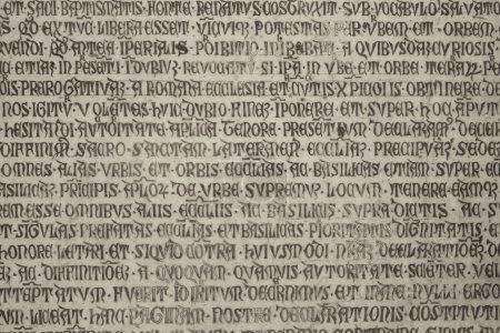Photo for Old medieval latin catholic inscription sepia toned photo - Royalty Free Image