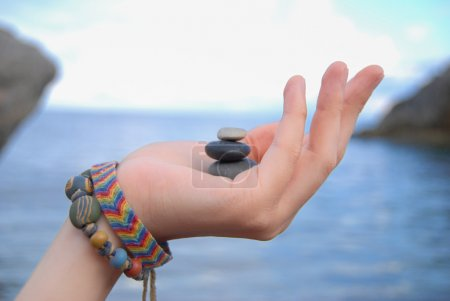 Photo for Woman's hand holding stones - Royalty Free Image