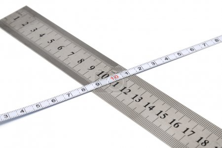White metal ruler and measuring tape