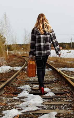 Girl on railroad