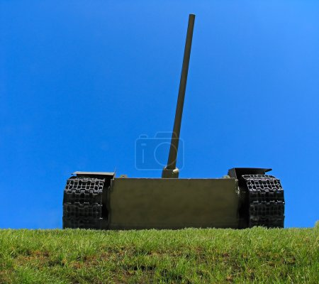 Old russian tank on the green grass