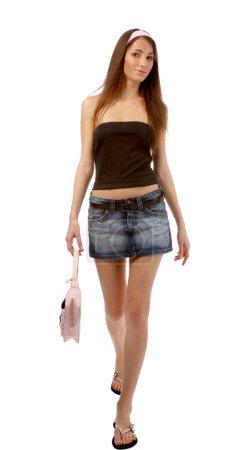 Model in jeans skirt