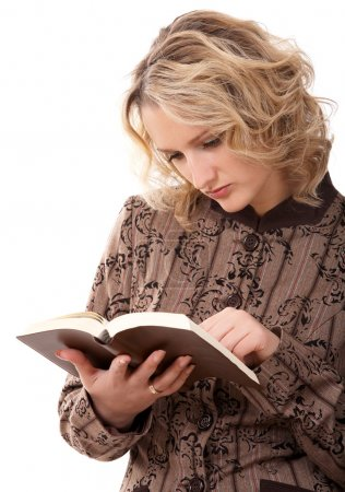 Photo for Blonde student girl reading a book on white background - Royalty Free Image