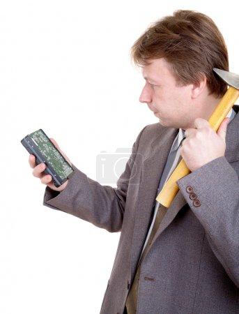 Photo pour Homme en costume avec disque dur et marteau - image libre de droit