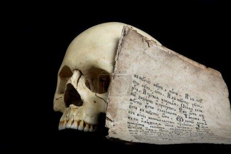 Cranium and old manuscript