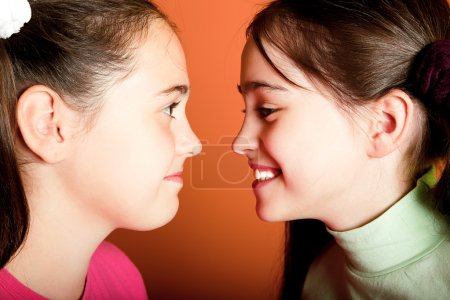 Photo for Two funny young girls look at each other - Royalty Free Image