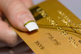 Gold bank card in arm