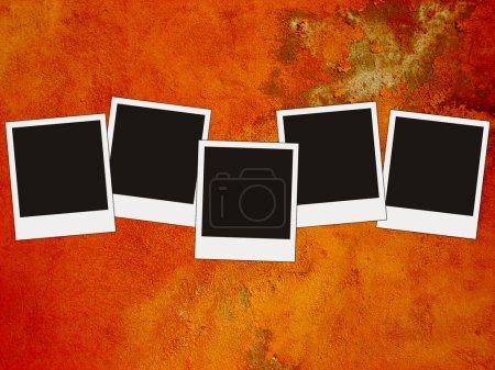 Five blank photos on grunge red acid bac
