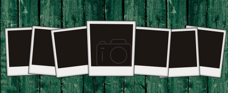 Photo for Vintage wooden wall with blank photos on it - Royalty Free Image