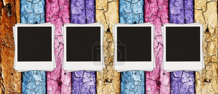 Photo for Vintage multicolored wooden wall with blank photos on it - Royalty Free Image