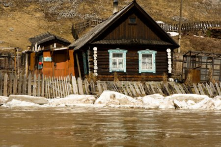 Old house on coast of the spread river