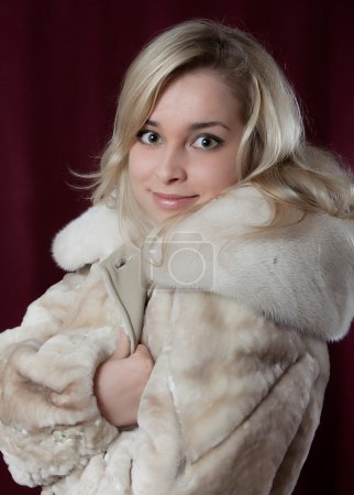 Portrait young beautiful girl in fur