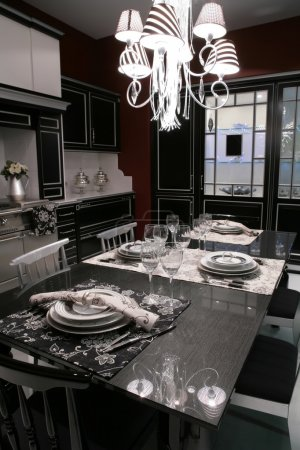 Modern dinning-room with served table
