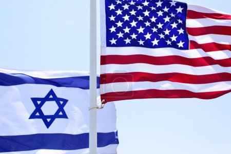 Flags of USA and Israel in the wind close-up...