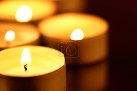 Photo for Burning warm candles close-up on a table - Royalty Free Image