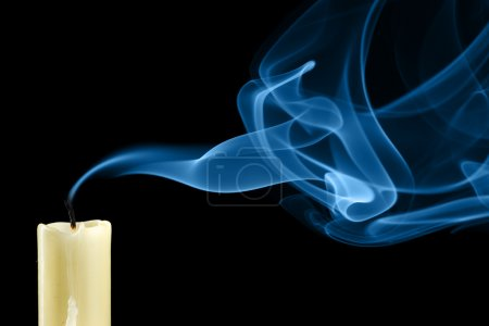 Extinguished candle with smoke close-up...