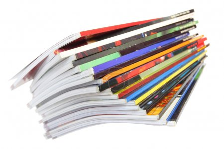 Photo for Pile of colorful magazines isolated over white background - Royalty Free Image