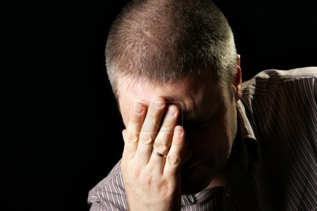 Photo for Worried man close up over black background - Royalty Free Image