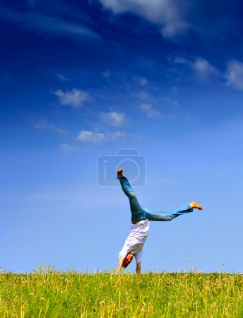 Photo for Freedom - Young girl have fun on the flank of hill - Royalty Free Image