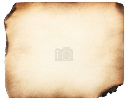 Foto de Viejo papel quemado, aislado sobre fondo blanco - Imagen libre de derechos